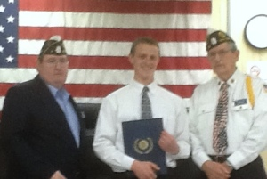 Alex Werden receives his award from District Commander Donald Bush (right) and 1st Vice Commander John Gault