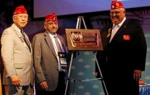 Jerry assists Past National Commander Wong at an award presentation